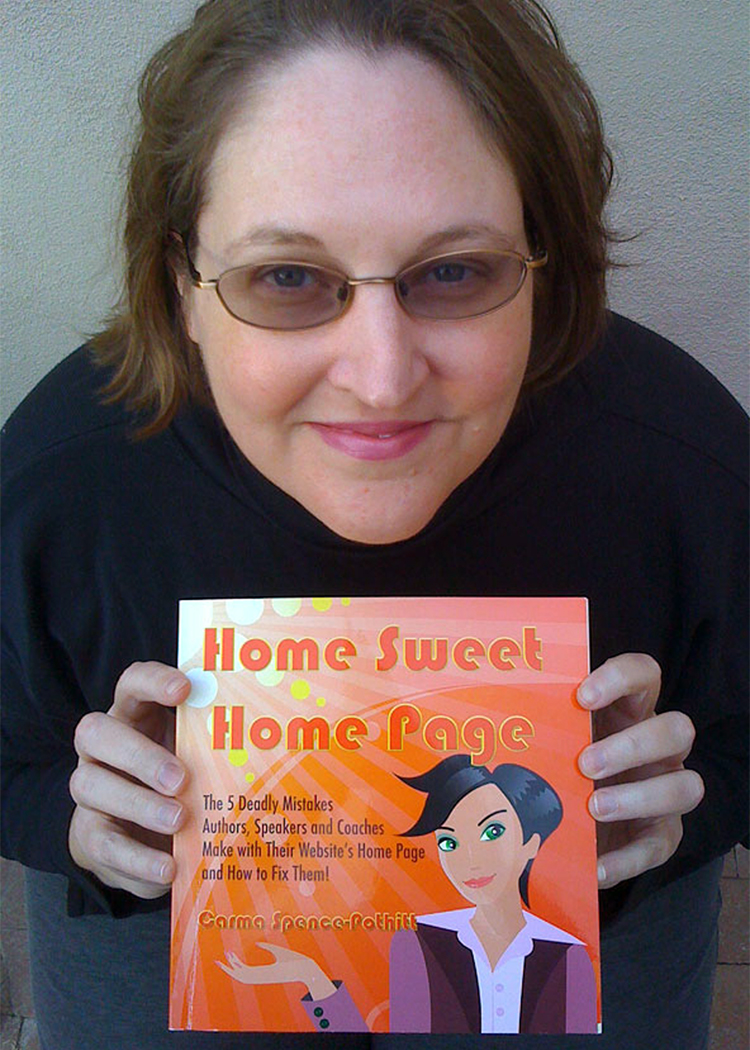 Carma holding first edition of Home Sweet Home Page